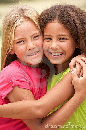 Free Two Girls In Park Giving Each Other Hug Stock Photography - 14687322