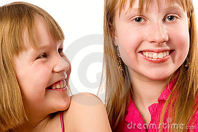 Two girls joyful smiling over white