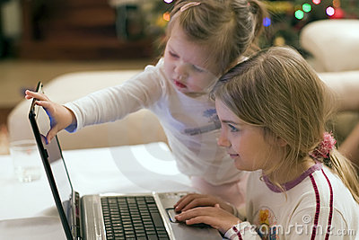 Two girls and laptop computer