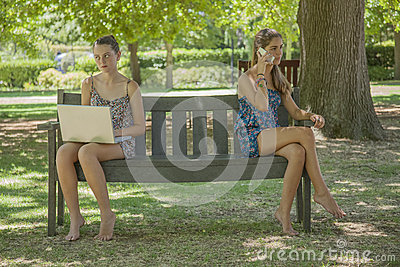 Two girls with laptop and smart phone