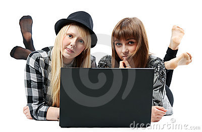 Two girls lies with computer