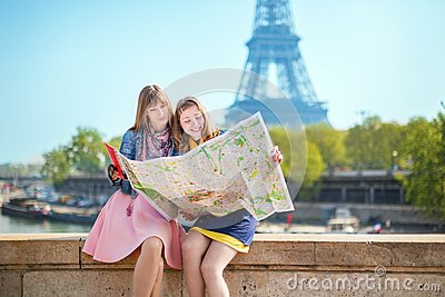 Two girls looking for direction in Paris