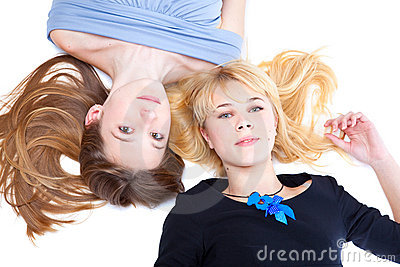 Two girls is lying on a floor