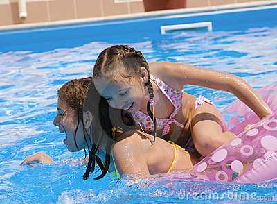 Two girls make merry in a pool