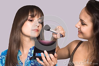 Two girls making up