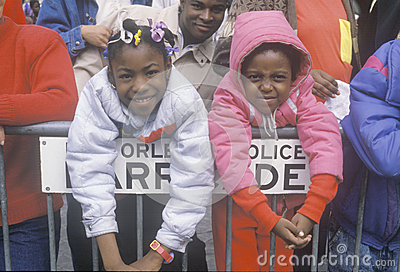 Two girls at the Mardis Gras parade Editorial Stock Photo
