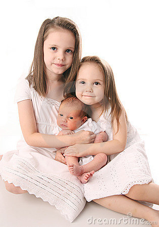 Two girls with newborn sister
