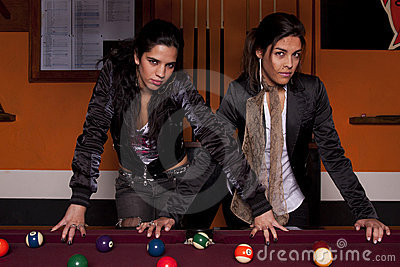 Two girls next to a snooker table