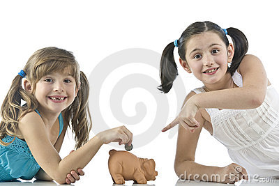 Two girls and piggy bank