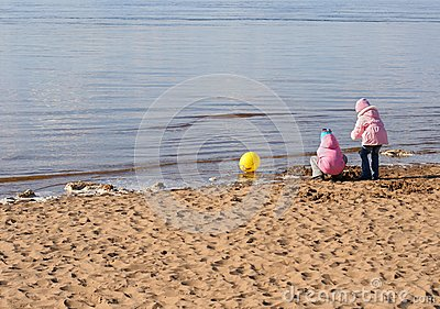 Two girls play on the beach