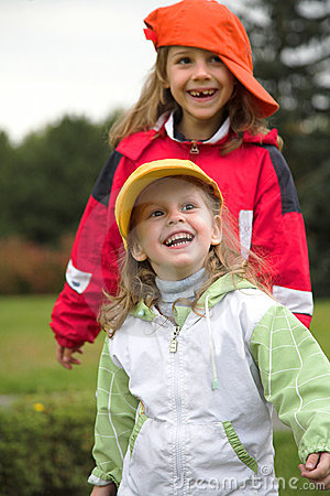 Two girls play with cap