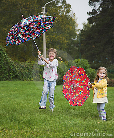 Free Two Girls Play With Umbrella Royalty Free Stock Image - 1288266