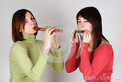 Two girls playing on flute and harp