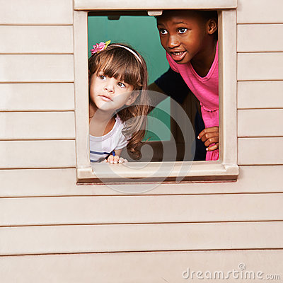 Free Two Girls Playing In Playhouse Stock Photography - 69651352