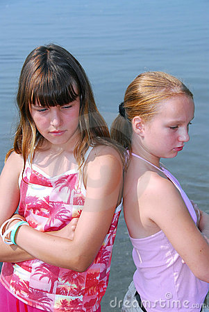 Two girls pouting