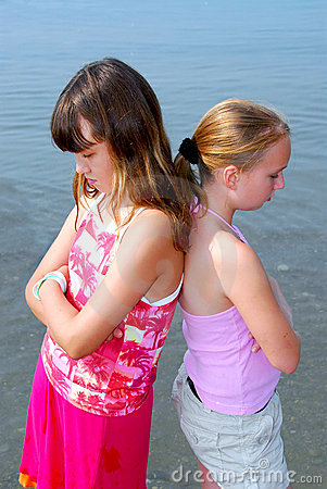 Two girls pouting
