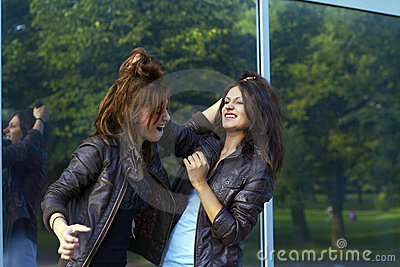 Two girls pulling each other s hair