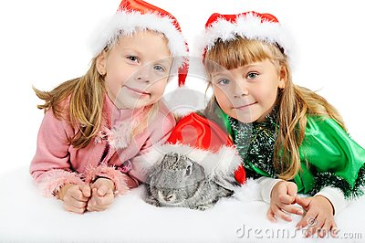Two girls with a rabbit on white