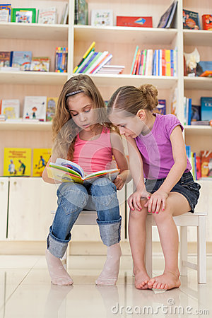 Free Two Girls Reading A Fascinating Book Stock Photo - 32482260