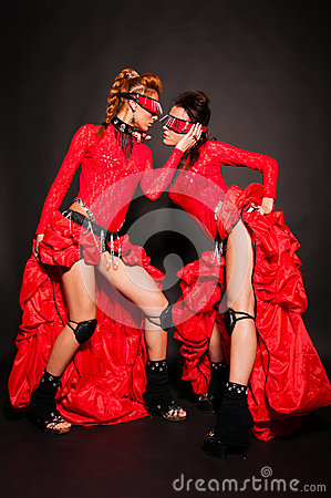 Two girls in red dresses