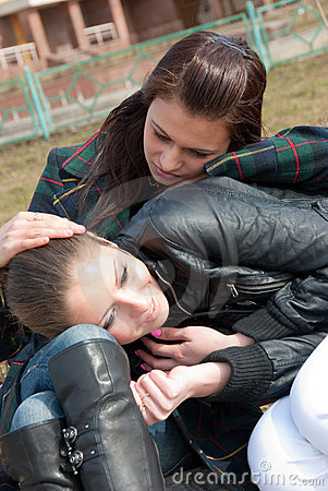 Two girls relax in a park