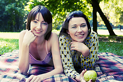 Two girls relaxing in park