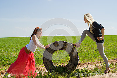 Two girls rolls wheel