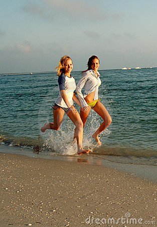 Two Girls Running on the Beach