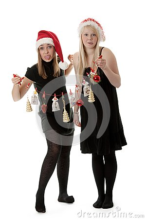 Two girls in the Santa hat