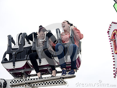 Two girls screaming on a fairground ride Editorial Image