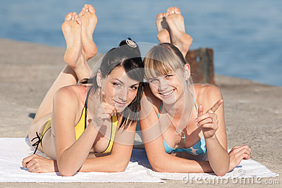 Two girls at the sea