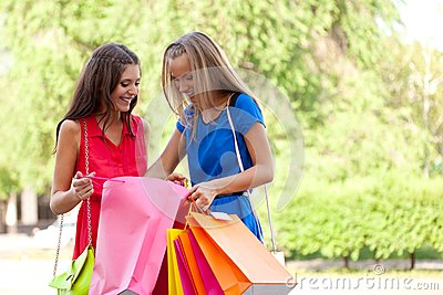 Two girls show each other the purchase