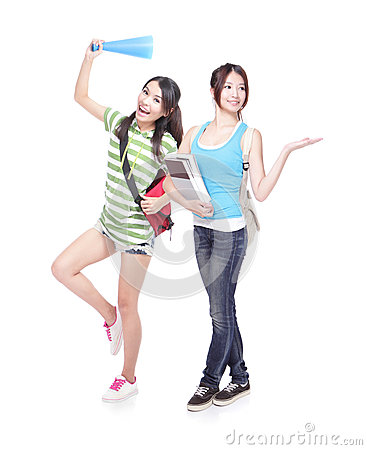 Two girls showing copy space by palm
