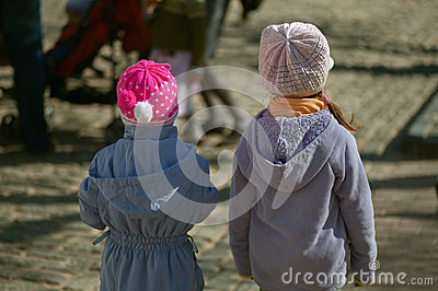Two girls-sisters from back