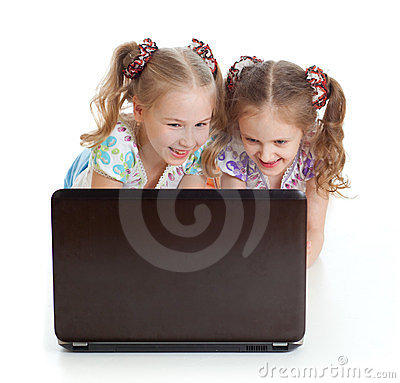 Two girls are smiling and looking at the laptop