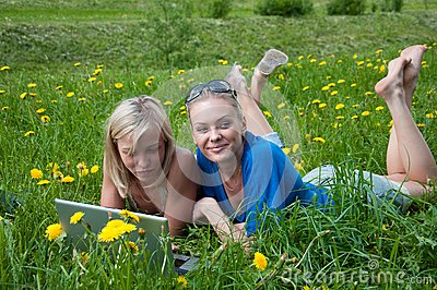 Two girls student with a laptop