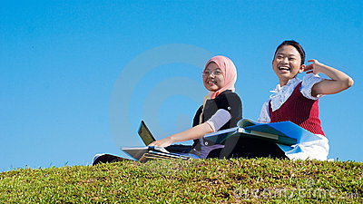 Two girls study happily