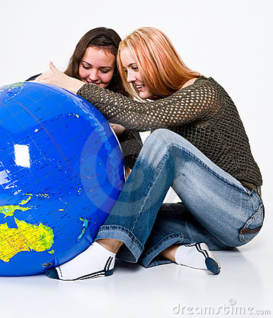 Free Two Girls Studying The Globe Royalty Free Stock Images - 4931199