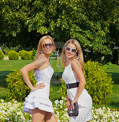 Two girls in summer park