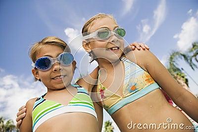 Two Girls (7-9) in swimwear portrait.