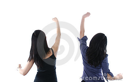 Two girls with their hands up