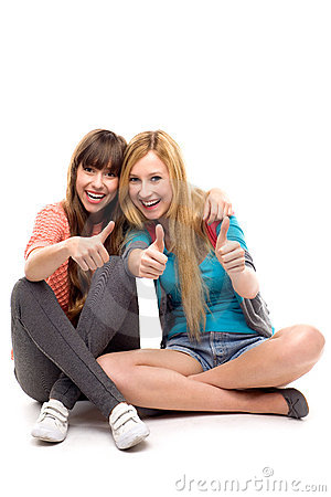 Two girls with thumbs up