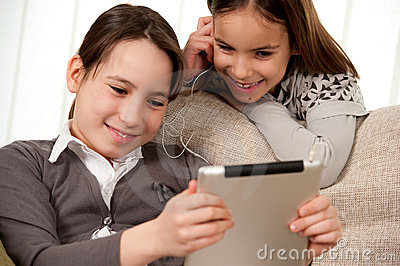 Two girls with touch tablet computer