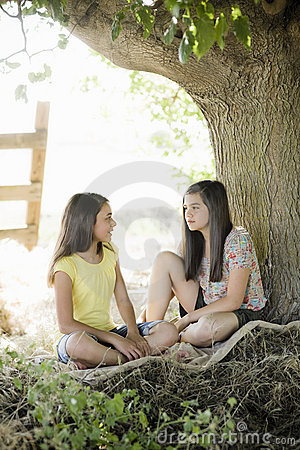 Two Girls Under A Tree Royalty Free Stock Photography