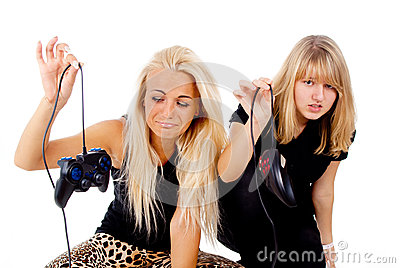 The two girls are unhappy with video games