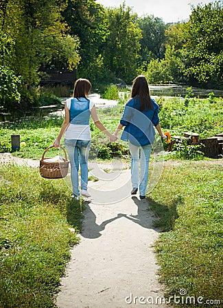 Two girls walking hand in hand