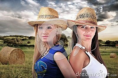 Two Girls Wearing cowboy Hats