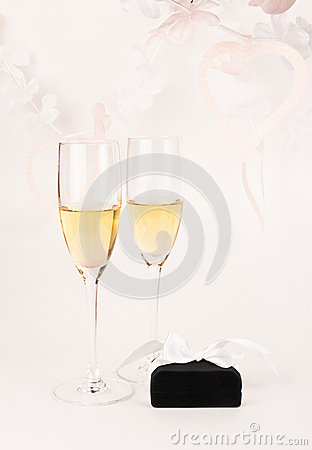 Two glass goblets and jewelry box on white