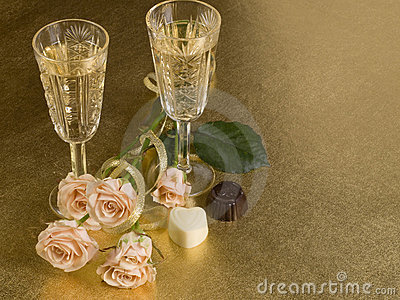 Two glass with wine and roses