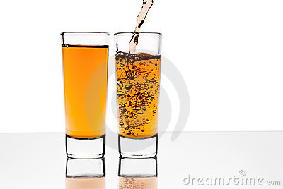 Two glasses with alcohol